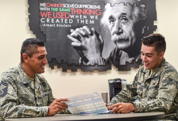 In this 2016 photo, Senior Master Sgt. Jose Diaz, the 59th Medical Wing career assistance advisor, briefs Airman 1st Class Felipe Morais, a 59th MDW personnel specialist, on retraining opportunities Sept. 22, 2016 at the Wilford Hall Ambulatory Surgical Center at Joint Base San Antonio-Lackland. Diaz advises Airmen on a wide array of subjects such as military benefits and entitlements, retraining, special duty assignments and professional development.