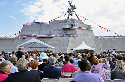 Audience members assemble for the commissioning ceremony of the Navy's newest littoral combat ship, USS Charleston (LCS 18).