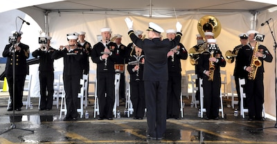 Members of the U.S. Fleet Forces Band and Joint Base Charleston Band play for the audience assembled for the commissioning ceremony of the Navy's newest littoral combat ship, USS Charleston (LCS 18).