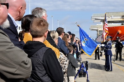 Sailors and Airmen from Joint Base Charleston, South Carolina, present the colors during the commissioning ceremony of the Navy's newest littoral combat ship, USS Charleston (LCS 18).