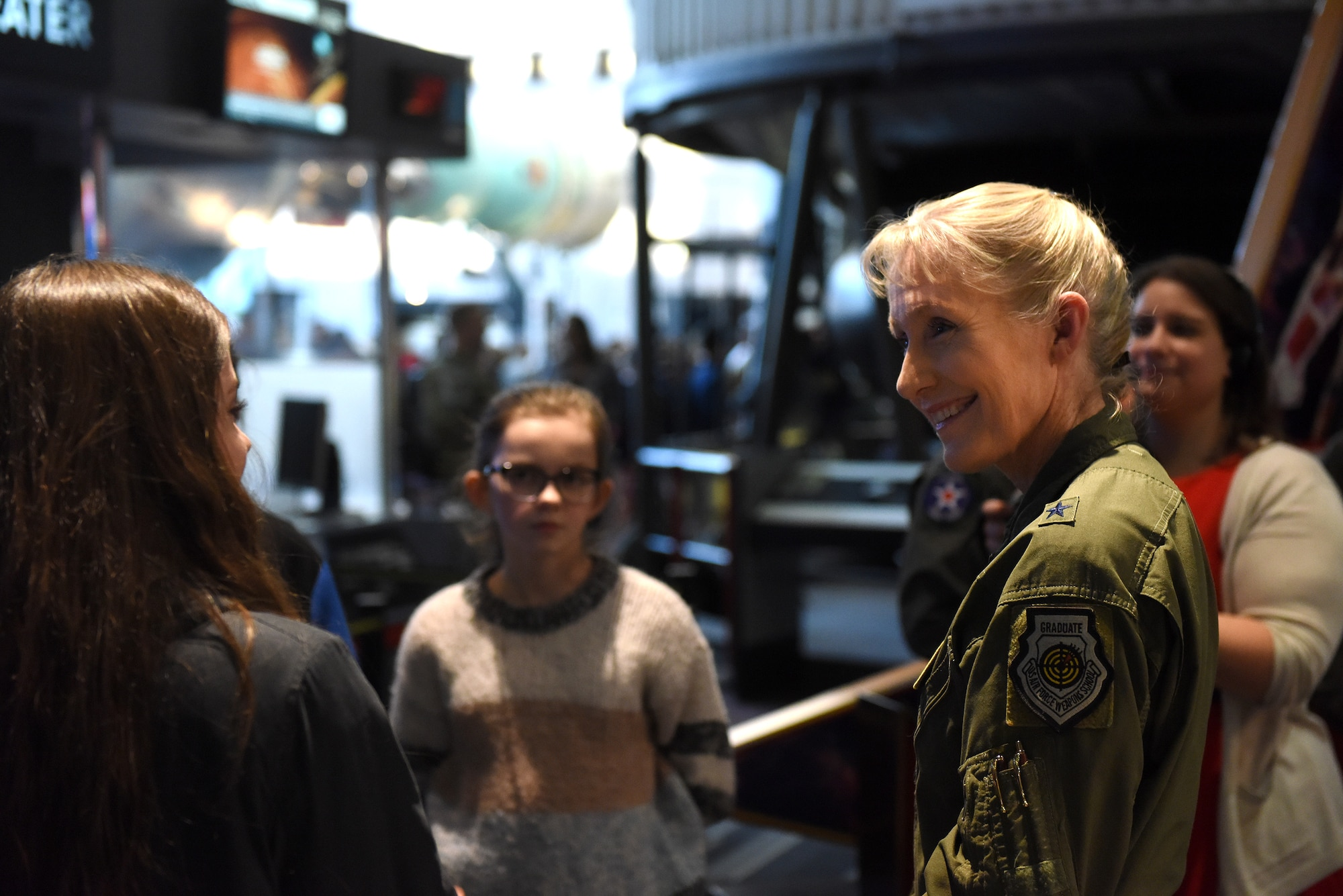 """Brig. Gen. Jeannie Leavitt, Air Force Recruiting Services commander, tours the STEM demonstration prior to a screening of the movie """"Captain Marvel"""" in Washington, D.C., March 7, 2019. The demonstration was held to inspire children to serve in the Air Force or STEM-related careers. (U.S. Air Force photo by Staff Sgt. Rusty Frank)"""