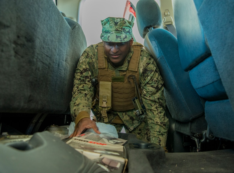 Master-at-Arms Petty Officer 3rd Class Larry Pool, Coastal Riverine Squadron 10 Bravo 2nd Platoon, performs a vehicle inspection during one of the simulations for a deployment exercise March 6, 2019, at Joint Base Charleston, S.C. -- Naval Weapons Station.