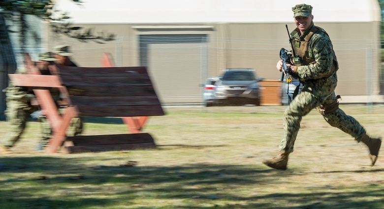 Master-at-Arms Petty Officer 3rd Class Adam Bolas, Coastal Riverine Squadron 10 Bravo 2nd Platoon, runs across the compound during one of the simulations for a deployment exercise March 6, 2019, at Joint Base Charleston, S.C. -- Naval Weapons Station.