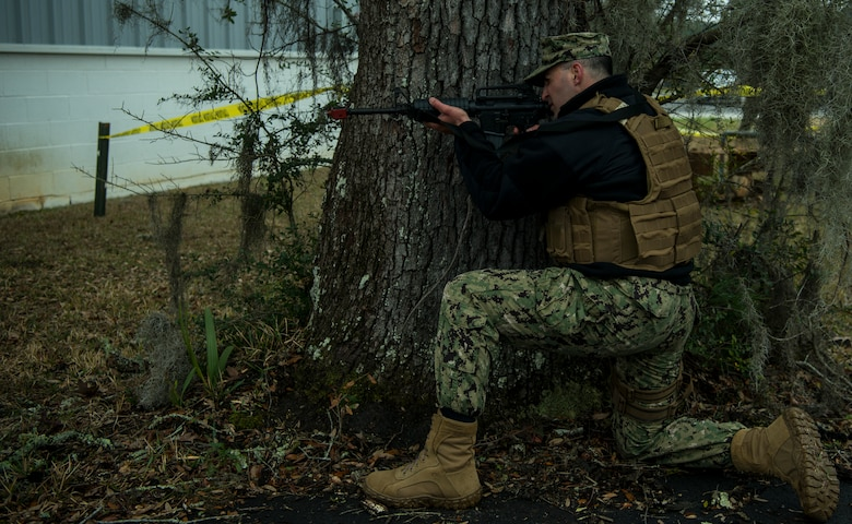 Master-at-Arms Petty Officer 3rd Class Samuel Dauphin, Coastal Riverine Squadron 10 Bravo 2nd Platoon, assumes a firing stance during a deployment exercise March 5, 2019, at Joint Base Charleston, S.C. -- Naval Weapons Station.