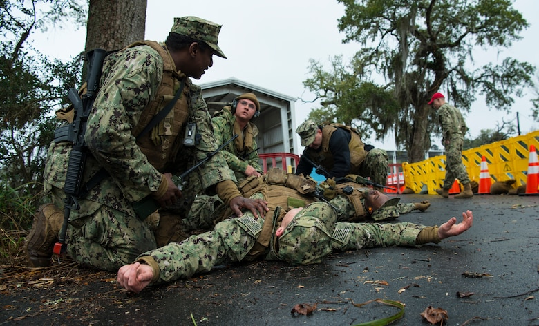 Sailors from the Coastal Riverine Squadron 10 Bravo 2nd Platoon perform first aid procedures on a simulated casuality during a deployment exercise March 5, 2019, at Joint Base Charleston, S.C. -- Naval Weapons Station.