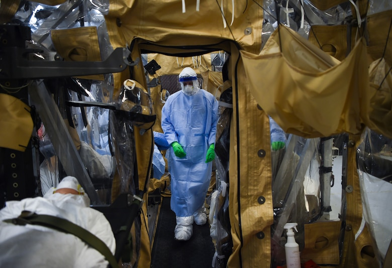 An Airman performs the final set of checks during transportation isolation system training March 5, 2019, while practicing patient care in a containment unit at Joint Base Charleston, S.C. Engineered and implemented after the Ebola virus outbreak in 2014, the TIS is an enclosure the Department of Defense can use to safely transport patients with highly contagious diseases.