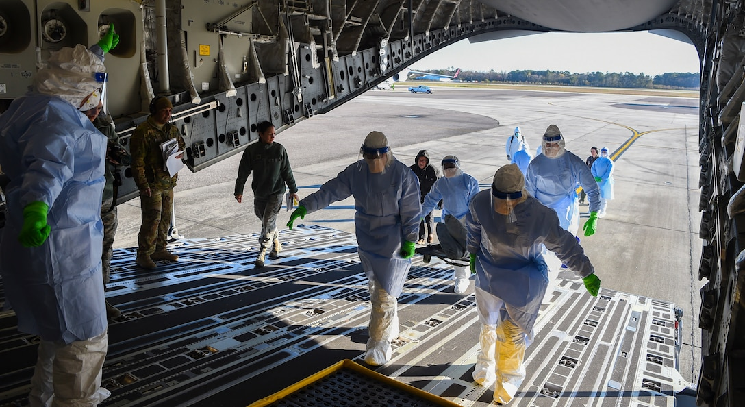 Airmen transport simulated patients onto a C-17 Globemaster III during a transportation isolation system training exercise March 6, 2019, at Joint Base Charleston, S.C. Engineered and implemented after the Ebola virus outbreak in 2014, the TIS is an enclosure the Department of Defense can use to safely transport patients with highly contagious diseases.