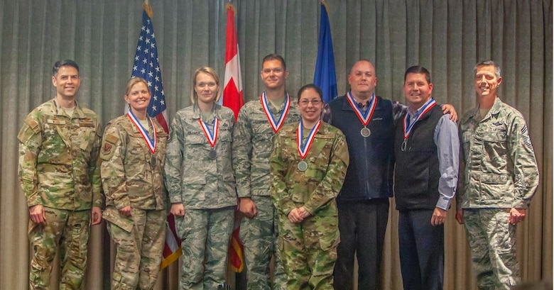 The 2018 552nd Air Control Wing annual award winners pose for a photo Feb. 22, 2019, at the Tinker Event Center. Front row: Col. Geoffrey Weiss, 552nd ACW Commander; Maj. Katherine Onstad; Master Sergeant Mary Cramer; Capt. Sean Stephens; Tech. Sgt. Heather King; Christopher Guth; Patrick Wilson; and Chief Master Sgt. Raymond Mott, 552nd ACW command chief. Missing: Senior Airman Brielle Golden; Senior Master Sgt. Justin Stacey; and Jenny Smith. (U.S. Air Force photo Master Sgt. Michael Remillard).