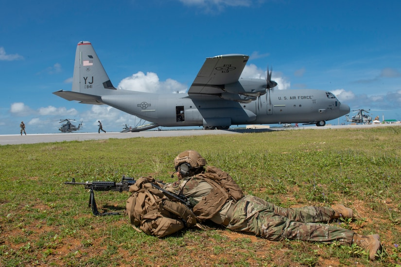 Airman with weapon and a C-130