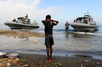 On January 12, 2010, a magnitude 7.0 earthquake strikes Haiti. The U.S. Navy is a key contributor to Operation Unified Response, which delivers more than 2.6 million bottles of water, 2.2 million food rations, 17 million pounds of food and 149,000 pounds of medical supplies. (U.S. Navy photo by Mass Communication Specialist 2nd Class Kristopher Wilson/Released)