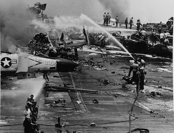 On July 29, 1967, onboard USS Forrestal (CVA-59), a Zuni rocket fires from an F-4B Phantom into an A-4E Skyhawk, sets off a series of explosions and fires that kill 134 and injure 161 crewmembers. Today, Sailors are still taught the damage control and firefighting lessons learned that day.