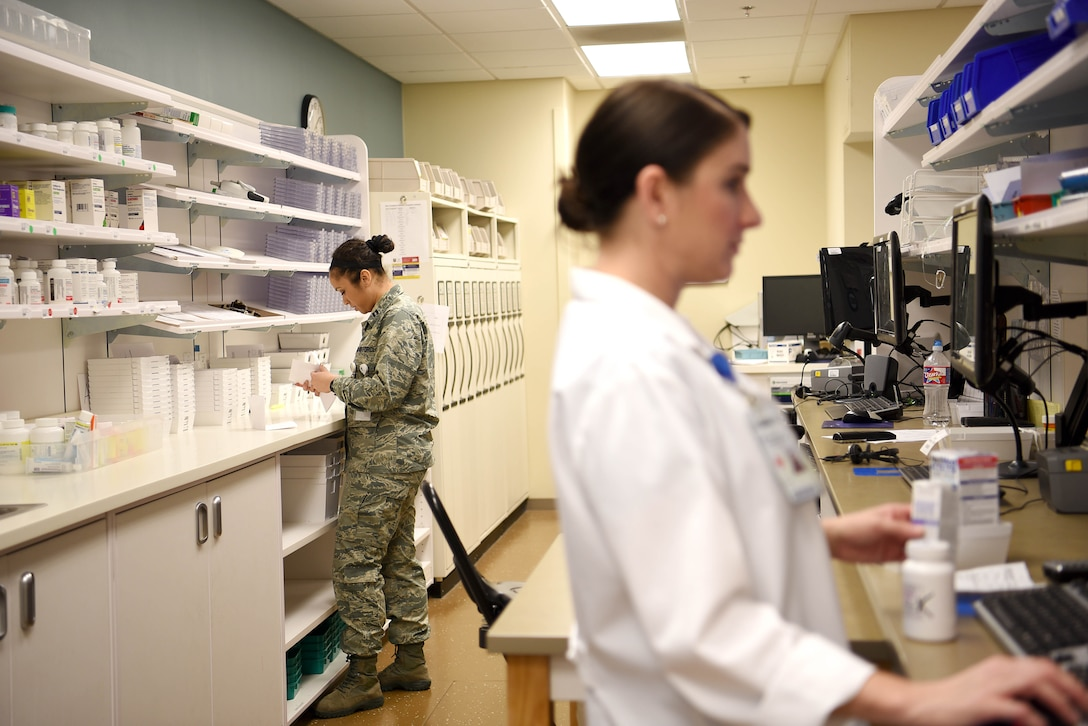 U.S. Air Force Capt. Whitney Howard, 14th Medical Support Squadron pharmacist, works on refilling prescriptions at Columbus Air Force Base, Mississippi, March 4, 2019. Pharmacists work with technicians to approve prescriptions and ensure customers are receiving the right care. (U.S. Air Force photo by Airman 1st Class Keith Holcomb)