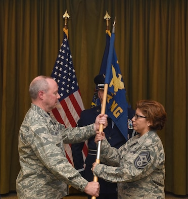 State Command Chief Master Sgt. Regina Stoltzfus receives the guidon from Col. Mike Regan, Commander, Pennsylvania Air National Guard, as she accepts responsibility as the ninth state command chief master sergeant. The passing of the guidon signifies the passing of the responsibility for all PA ANG enlisted personnel