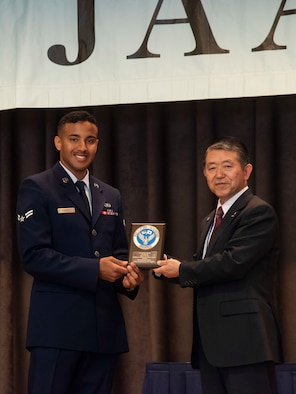 U.S. Air Force Airman 1st Class William Raley, left, a 610th Air Control Flight weapons director technician, receives the 2019 Japan-America Air Force Goodwill Association award from Japan Air Self-Defense Force Ret. Gen. Shigeru Iwasaki, the JAAGA president, at Misawa Air Base, Japan, March 6, 2019. Raley received the award for continuously bolstering the U.S.-Japan alliance on and off base. (U.S. Air Force photo by Senior Airman Sadie Colbert)