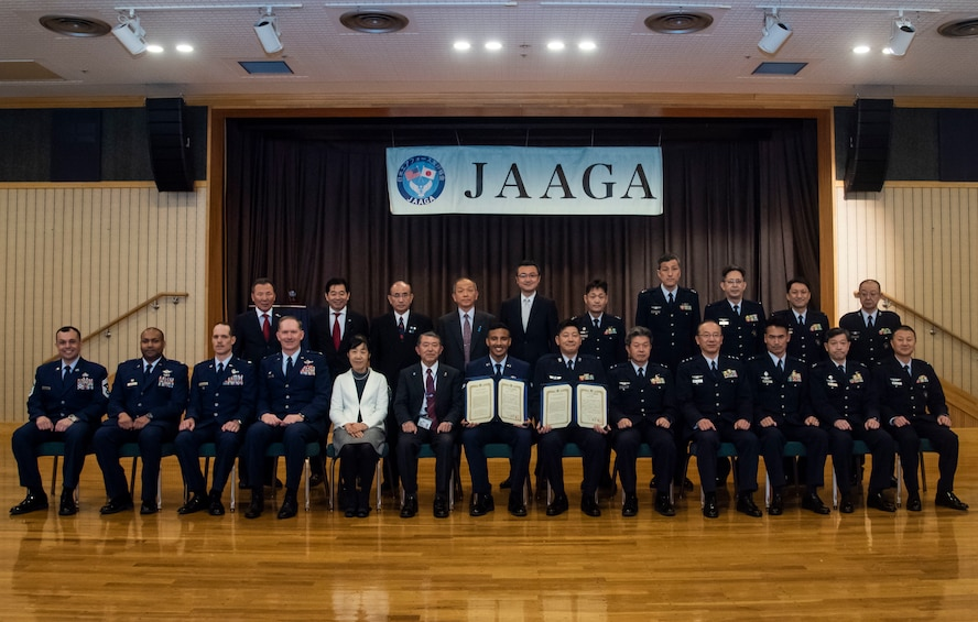 U.S. Air Force 35th Fighter Wing Airmen and the Japan-America Air Force Goodwill Association leaders pose for a group photo after a JAAGA award ceremony at Misawa Air Base, Japan, March 6, 2019. Misawa City established the association 21 years ago and ever since, Misawa AB and the JAAGA members held award ceremonies to honor the selected U.S. Air Force and Japan Air Self-Defense Force enlisted service members, who strive to build the U.S. and Japan partnership. (U.S. Air Force photo by Senior Airman Sadie Colbert)