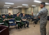 Japan Air Self-Defense Force Airmen with the 601st Squadron, Airspace Warning Control Wing, listens to U.S. Air Force Airman 1st Class William Raley, a 610th Air Control Flight weapons director technician, as he teaches an English class at Misawa Air Base, Japan, March 7, 2019. Raley regularly taught English classes on and off base, this being one of the many reasons he won the Japan-America Air Force Goodwill Association award for 2018. (U.S. Air Force photo by Senior Airman Sadie Colbert)