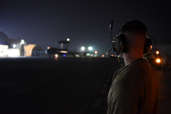 An 380th Expeditionary Aircraft Maintenance Squadron crew chief member watches as an E-3 Sentry taxis into Al Dhafra Air Base, United Arab Emirates, Mar. 7, 2019.