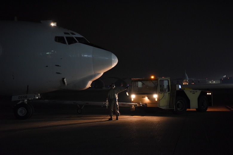 An E-3 Sentry is towed into its parking spot after landing at Al Dhafra Air Base, United Arab Emirates, Mar. 7, 2019.