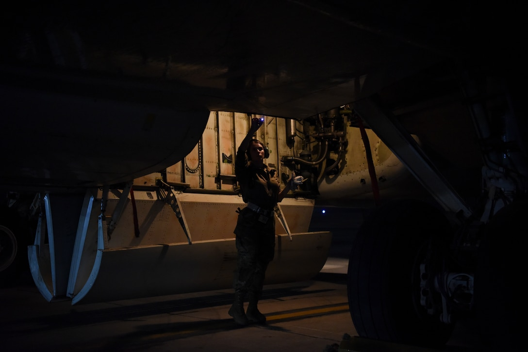 Senior Airman Larissa Locke, 380th Expeditionary Aircraft Maintenance Squadron hydraulics systems specialist, inspects the compartments of an E-3 Sentry after landing at Al Dhafra Air Base, United Arab Emirates, Mar. 7, 2019.