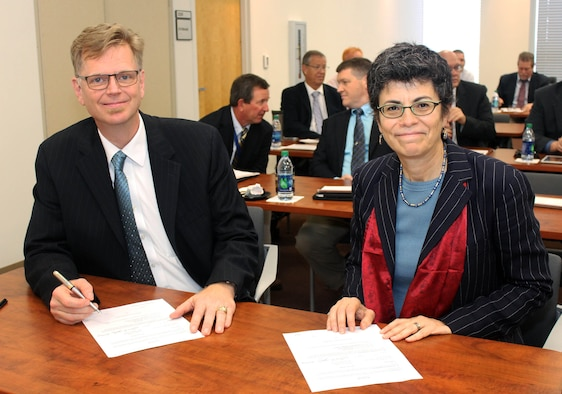 Dr. Glenn E. Sjoden (left) and Dr. Gisele Bennett (right) prepare to renew the Cooperative Research and Development Agreement between the Air Force Technical Applications Center and the Florida Institute of Technology March 1, 2019 on the FIT campus in Melbourne, Florida.  Sjoden, AFTAC's chief scientist, and Bennett, FIT's senior vice president for research, signed the CRADA to allow for scientific collaboration between the two organizations.  (Florida Institute of Technology photo by Adam Lowenstein)