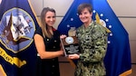 Defense Logistics Agency Indo-Pacific Commander Navy Capt. Kristin Acquavella recognized DLA Intelligence Indo-Pacific Security Specialist Sheena Gufford as the 2018 DLA Security Professional of the Year March 8.