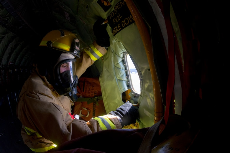 A Wyoming Air National Guard firefighter from the 153rd Airlift Wing in Cheyenne, Wyo., closes the port hole on a KC-135 Stratotanker aircraft during a joint firefighting training exercise with 6th Civil Engineer Squadron firefighters at MacDill Air Force Base, Fla., March 6, 2019.
