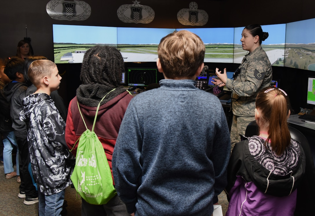 U.S. Air Force Tech. Sgt. Carolyn Alexander, 334th Training Squadron instructor, provides an air traffic control tower simulator demonstration to school-aged children during Biloxi School District Career Exploration Day on Keesler Air Force Base, Mississippi, March 7, 2019. The children also toured the Keesler Fire Department, 335th TRS weather facility and received a demonstration from the 81st Security Forces Squadron military working dogs. (U.S. Air Force photo by Kemberly Groue)