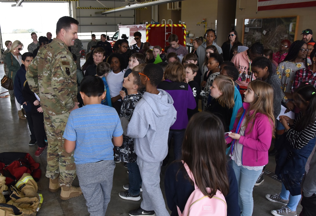 U.S. Air Force Col. Lance Burnett, 81st Training Wing vice commander, delivers closing remarks to school-aged children during Biloxi School District Career Exploration Day on Keesler Air Force Base, Mississippi, March 7, 2019. Throughout their visit, the children toured the 334th Training Squadron air traffic control school, 335th TRS weather facility, the Keesler Fire Department and received a demonstration from the 81st Security Forces Squadron military working dogs. (U.S. Air Force photo by Kemberly Groue)