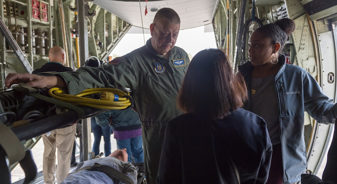 U.S. Air Force Master Sgt. Joe Byrd, 36th Aeromedical Evacuation Squadron aeromedical technician, discusses on-board medical procedures to Keesler honorary commanders inside a WC-130J Hercules during the 403rd Wing Honorary Commanders Tour at Keesler Air Force Base, Mississippi, March 08, 2019. The tour was intended to familiarize honorary commanders with the 403rd Wing and the Air Force Reserve mission and capabilities. The event also included an incentive flight on a WC-130J Hercules. (U.S. Air Force Photo by Andre' Askew)