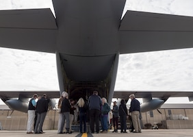 Keesler honorary commanders gather at the rear of a WC-130J Hercules during the 403rd Wing Honorary Commanders Tour at Keesler Air Force Base, Mississippi, March 08, 2019. The tour was intended to familiarize honorary commanders with the 403rd Wing and the Air Force Reserve mission and capabilities. The event also included an incentive flight on a WC-130J Hercules. (U.S. Air Force Photo by Andre' Askew)