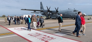 Keesler honorary commanders exit the flight line following a static display tour of a WC-130J Hercules during the 403rd Wing Honorary Commanders Tour at Keesler Air Force Base, Mississippi, March 08, 2019. The tour was intended to familiarize honorary commanders with the 403rd Wing and the Air Force Reserve mission and capabilities. The event also included an incentive flight on a WC-130J Hercules. (U.S. Air Force Photo by Andre' Askew)