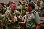 Washington Air National Guard Brig. Gen. Jeremy Horn talks with his Malaysia Armed Forces counterpart, Maj. Gen. Dato' Haji Mohd Yusof Bin Aziz, following the opening ceremony of Exercise Bersama Warrior, March 6, 2019 in Kuala Lumpur.