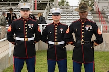 Pvt. Michael Campofiori stands alongside Sgt. William Todd, his recruiter, and Staff Sgt. Roy A. Covington III, his senior drill instructor, during his Marine Corps recruit training graduation at Marine Corps Recruit Depot Parris Island, South Carolina, Mar. 8, 2019.  Campofiori, a native of Township, New Jersey, overcame Leukemia as a child and has now achieved his lifelong goal of becoming a Marine. (U.S. Marine Corps photo by Sgt. Jorge A. Rosales)