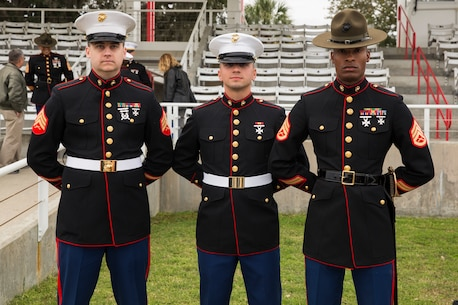 Pvt. Michael Campofiori stands alongside Sgt. William Todd, his recruiter, and Staff Sgt. Roy A. Covington III, his senior drill instructor, during his Marine Corps recruit training graduation at Marine Corps Recruit Depot Parris Island, South Carolina, March 8, 2019.  Campofiori, a native of Township, New Jersey, overcame Leukemia as a child and has now achieved his lifelong goal of becoming a Marine. (U.S. Marine Corps photo by Sgt. Jorge A. Rosales)