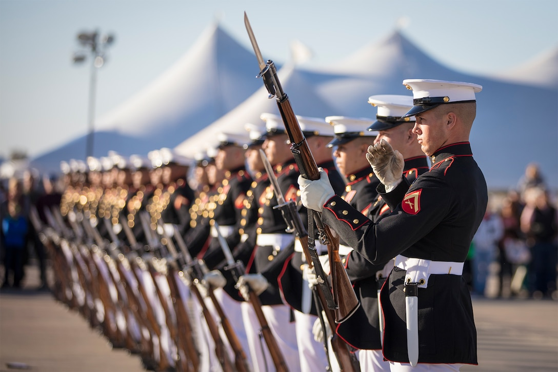Marines assigned to the Battle Color Detachment perform.