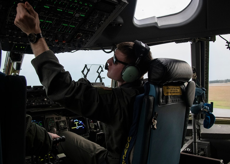 1st Lt. Marcus Malecek, a C-17 Globemaster III pilot, prepares for takeoff March 3, 2019, from Dover Air Force Base, Del., as a part of Exercise Jersey Devil 19. The exercise is intended to ensure Airmen are ready to respond to complex threats in any environment both now and in the future. (U.S. Air Force photo by Airman 1st Class Zoe M. Wockenfuss)