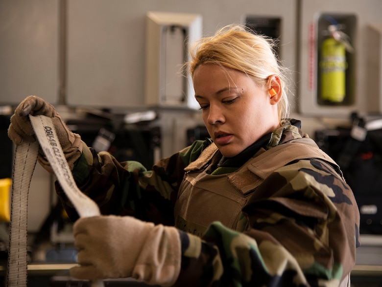 Staff Sgt. Erica Funke, medical technician with the 514th Aeromedical Evacuation Squadron from Joint Base McGuire-Dix-Lakehurst, N.J., secures a gurney aboard a C-17 Globemaster III during Exercise Jersey Devil 19 in Gulfport, Miss., March 4, 2019. Throughout the exercise the Airmen had to don Mission Oriented Protective Posture gear to protect from simulated contaminates. (U.S. Air Force photo by Airman 1st Class Zoe M. Wockenfuss)