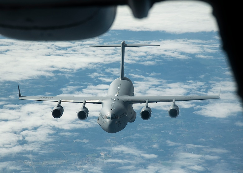 A C-17 Globemaster III from the 436th Airlift Wing, Dover Air Force Base, Del., flies behind a KC-10 Extender from the 305th Air Mobility Wing, Joint Base McGuire-Dix-Lakehurst, N.J., March 7, 2019, during Exercise Jersey Devil 19. Jersey Devil is the largest joint base mobility exercise since 2009 with six units including both active duty and reserve Airmen. (U.S. Air Force photo by Airman 1st Class Zoe M. Wockenfuss)