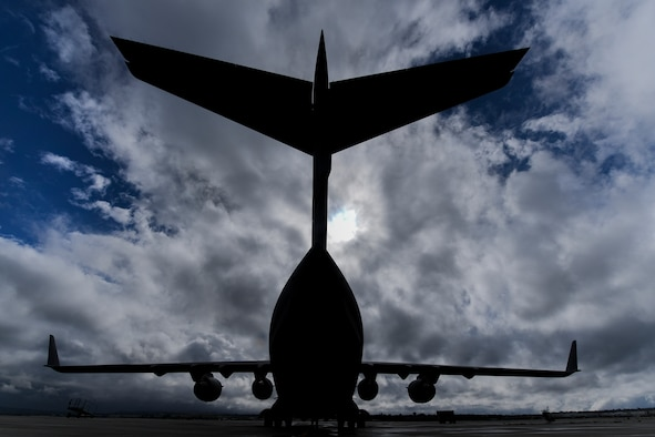 A C-17 Globemaster III assigned to the 911th Airlift Wing sits on the flightline at March Air Reserve Base, California, March 6, 2018. The C-17 Globemaster III is at at March ARB along with approximately 20 members from the 911th Maintenance Group due the flightline and aircraft conversion their home station is currently undergoing. (U.S. Air Force photo by Joshua J. Seybert)