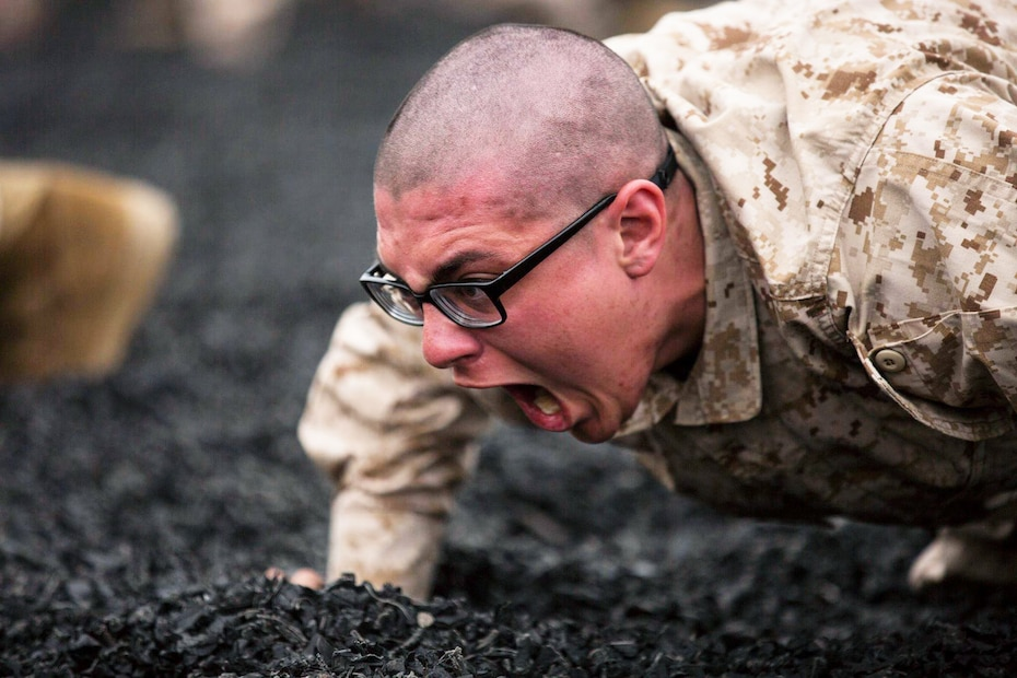 A recruit with Mike Company, 3rd Recruit Training Battalion, war-cries while conducting warm-ups during a Marine Corps Martial Arts Program training session at Marine Corps Recruit Depot San Diego, March 6.