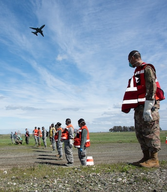 U.S. Air Force Airman assigned to the 60th Medical Group, search a debris ield during the recovery phase at a simulated crash site during a major accident response exercise, Feb. 28, 2019, Travis Air Force Base, California. The MARE was used to evaluate how different base agencies respond to emergency situations. (U.S. Air Force photo by Heide Couch)