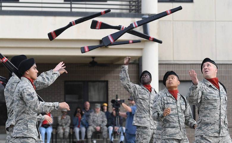 Members of the 335th Training Squadron freestyle drill team perform during the 81st Training Group drill down on the Levitow Training Support Facility drill pad at Keesler Air Force Base, Mississippi, March 8, 2019. Airmen from the 81st TRG competed in a quarterly open ranks inspection, regulation drill routine and freestyle drill routine. Keesler trains more than 30,000 students each year. While in training, Airmen are given the opportunity to volunteer to learn and execute drill down routines. (U.S. Air Force photo by Kemberly Groue)