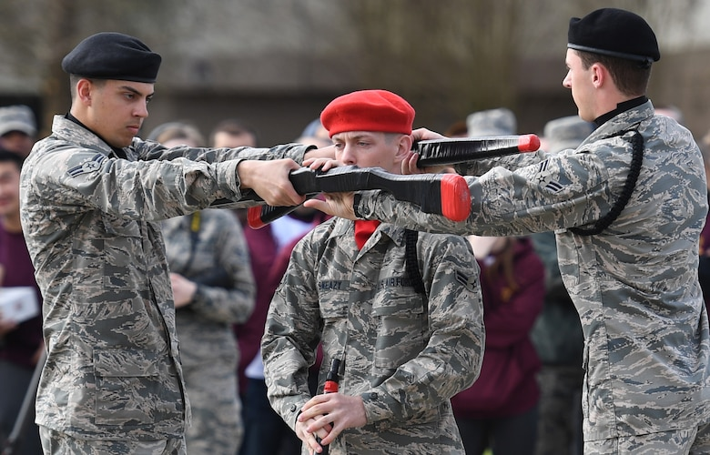 U.S. Air Force Airmen 1st Class Evan Berglund, Ryan Sweazy and Christopher Strnad, 336th Training Squadron freestyle drill team members, perform during the 81st Training Group drill down on the Levitow Training Support Facility drill pad at Keesler Air Force Base, Mississippi, March 8, 2019. Airmen from the 81st TRG competed in a quarterly open ranks inspection, regulation drill routine and freestyle drill routine. Keesler trains more than 30,000 students each year. While in training, Airmen are given the opportunity to volunteer to learn and execute drill down routines. (U.S. Air Force photo by Kemberly Groue)