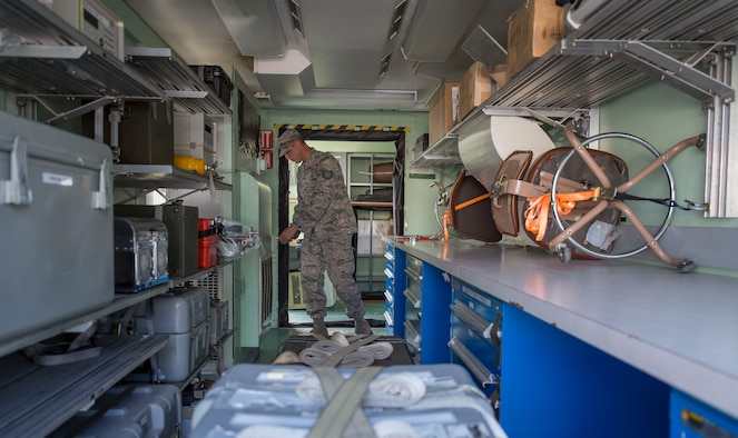 Tech. Sgt. Jaime Gardiner, a precision measurement equipment laboratory craftsman assigned 366th Component Maintenance Squadron at Mountain Home Air Force Base, Idaho, sets up a rapid assistance calibration lab on Joint Base Pearl Harbor-Hickam, Hawaii, Jan. 28, 2019. The RASCAL operates as a mobile PMEL module and can be sent out in support of overseas contingency operations. At JBPHH, the RASCAL will serve as the primary precision measurement equipment laboratory while renovations are underway at the current facility.  (U.S. Air Force photo by Tech. Sgt. Heather Redman)