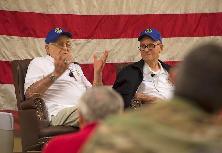 World War II veteran answers question alongside other veterans