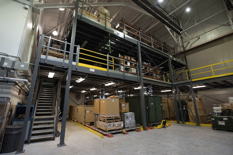 A newly constructed three-story vertical parts storage system is installed in the newly remodeled 24/7 aircraft parts store March 8, 2019, at Joint Base Elmendorf-Richardson, Alaska. In one of the newest total force integration associations of its kind, the 673d LRS Materiel Management flight is conducting a complete C-17 aircraft supply turnover to the 176th LRS. A remodel of both a warehouse and a newly renovated 24/7 aircraft parts store was conducted to take on the massive amount of inventory.