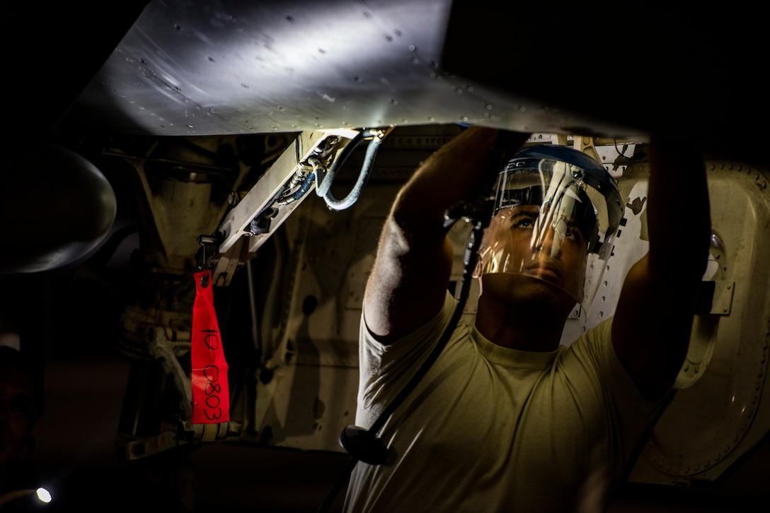 U.S. Air Force Staff Sgt. Josiah Baychu, 35th Aircraft Maintenance Squadron dedicated crew chief, services the emergency blowdown bottle during COPE Tiger 19 at Korat Royal Thai Air Force Base, Thailand, March 11, 2019.