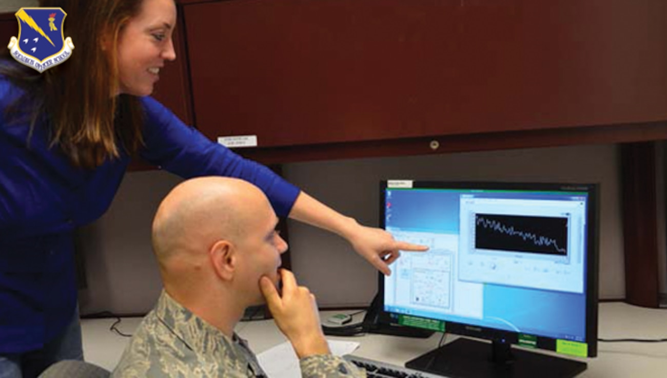 Squadron Officer School student learning from computer generated data