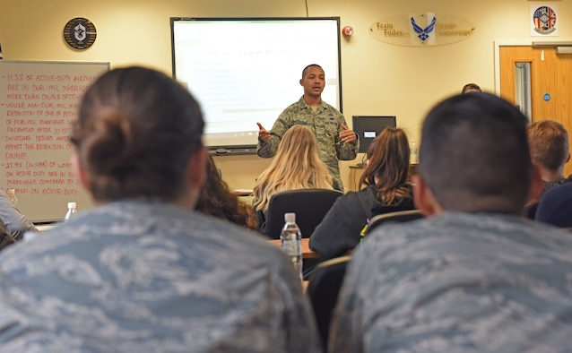 "U.S. Air Force Master Sgt. Abraham Walker, 100th Force Support Squadron career development section chief, gives a brief during a dual-military seminar at RAF Mildenhall, England, March 8, 2019. The seminar included lectures on dual-military assignments and ""The 5 Love Languages"" to help dual-military members with any issues they may encounter during their career. (U.S. Air Force photo by Senior Airman Luke Milano)"