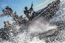 U.S. Marines and Sailors with the Maritime Raid Force, 11th Marine Expeditionary Unit, ride in a rigid-hull inflatable boat during a visit, board, search and seizure exercise.